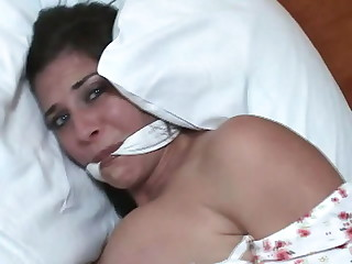 Gorgeous brunette girl Paige Allen gets tied up in the hotel room