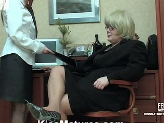 Chubby aged business woman and female co-worker getting down into lesbo