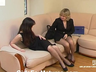 Older gal and young hotty pull down pantyhose whiling away time in hot lez action
