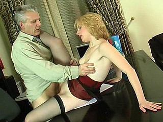 Wicked youthful secretary climbing her graying boss's desk for a hardcore fuck