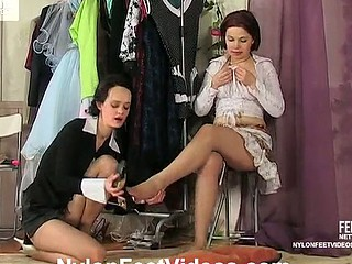 Lesbian gals in sheer hose playing numbers game after foot-caressing