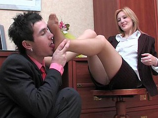 Steaming secretary throwing off her high heel shoes to play nylon footsy game