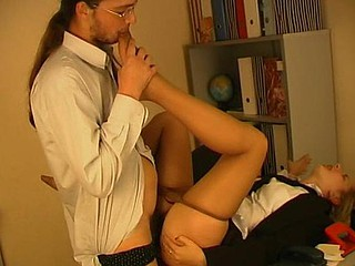 Horny secretary in smooth hose giving footjob in all ways possible