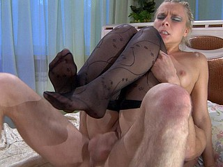 Footsie blond in black fashion tights rides a 10-Pounder after a steamy footjob