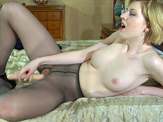 Ethereal golden-haired jamming a biggest toy thru her barely black crotchless tights