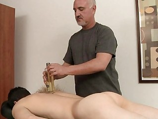 Skinny gay receives his hard cock oiled and massaged