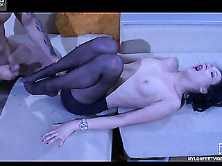 Lengthy-legged hottie milking a cock with her able feet in darksome nylon tights