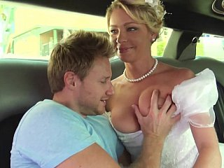 Bride in white beautiful dress gets drilled